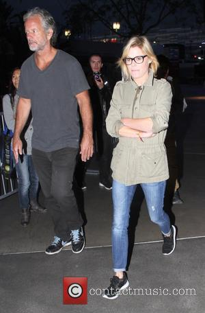 Julie Bowen - Celebrities arrive at the Staples Center to watch the Houston Rockets vs. Los Angeles Clippers game in...