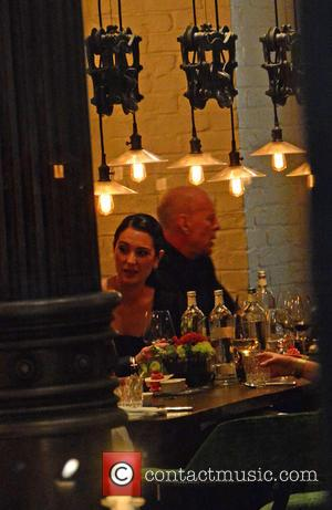 Bruce Willis and his wife Emma Heming-Willis having dinner - Celebrities at Grace bar and restaurant (Hotel am Zoo) in...
