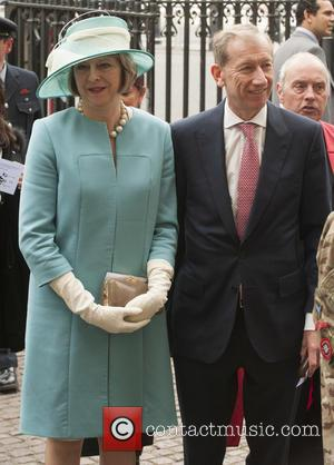 Theresa May - Members of the Royal family and politicians attends a service at Westminster Abbey to mark the 70th...