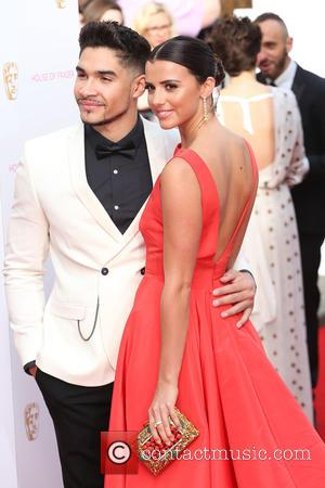Lucy Mecklenburgh and Louis Smith - A host of stars were photographed as they arrived for the House Of Fraser...