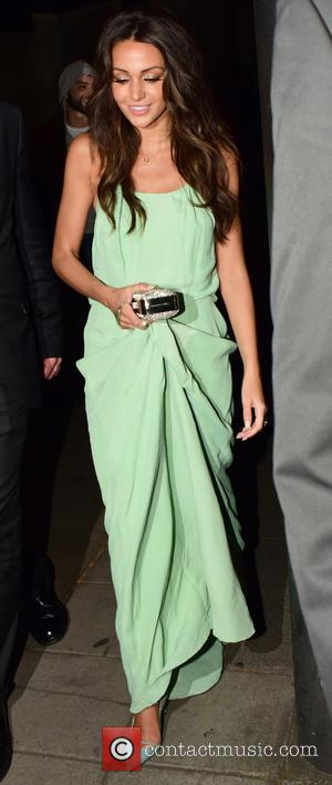 Michelle Keegan - House Of Fraser British Academy Television Awards (TV BAFTA) 2015 - Departures at w1 - London, United...