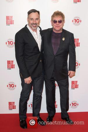 Elton John and David Furnish - Billy Elliot the musical 10th Anniversary at the Victoria Palace Theatre - Arrivals. at...