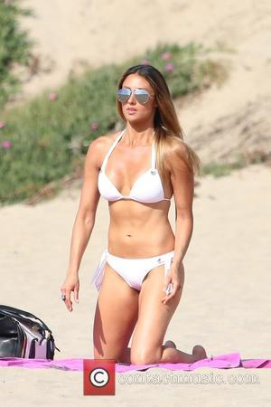 Katie Cleary - Katie Cleary spends the day on the beach in Malibu. Katie soon will be starring in 'Give...
