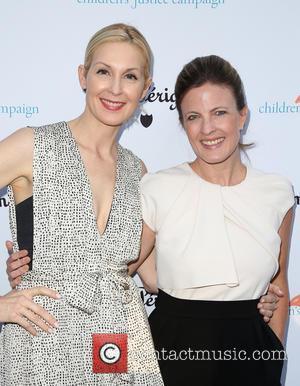Kelly Rutherford and Guest