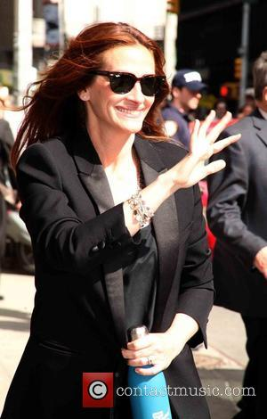 Julia Roberts - American actress Julia Roberts and David Letterman's musical director Paul Shaffer were photographed as they arrived at...