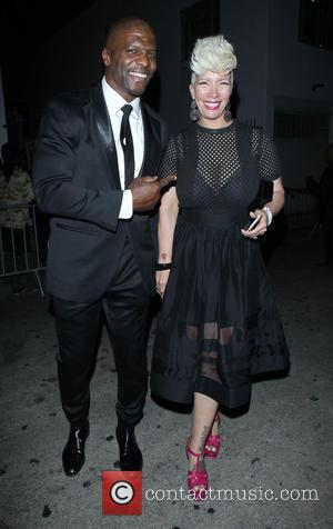 Terry Crews and Rebecca Crews - Terry Crews and wife his Rebecca Crews leaves Stevie Wonder's birthday party in Hollywood...