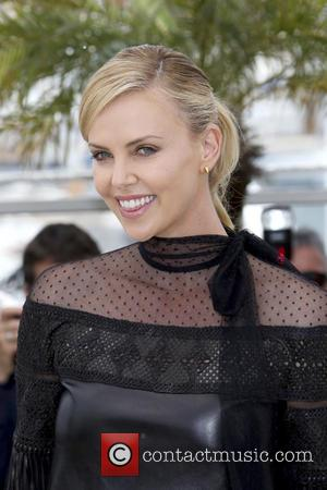Charlize Theron Pushes Mad Max's Global Warming Message At Cannes