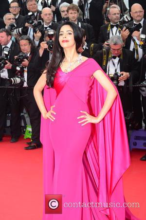 Mallika Sherawat - A host of stars were snapped as they took to the red carpet for the 68th Annual...