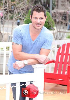 Nick Lachey - Nick Lachey puckers up for the Almay Kissing Booth at the Almay Simply American Experience - New...