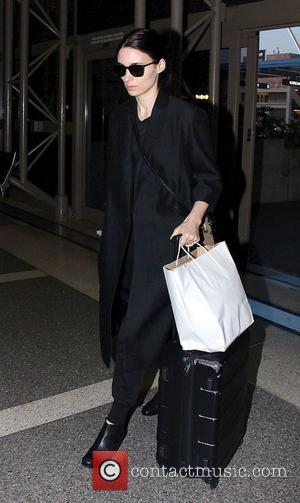 Rooney Mara - Rooney Mara and her boyfriend Charlie McDowell arrive at Los Angeles International (LAX) airport. at LAX -...