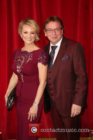 Gillian Taylforth and Adam Woodyatt - A host of stars from a variety of British soap operas were photographed as...