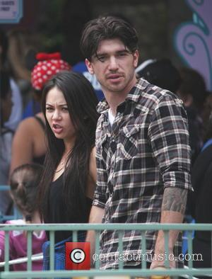 Janel Parrish - 'Pretty Little Liars' star Janel Parrish holds hands with male companion on the 'Alice in Wonderland' ride...