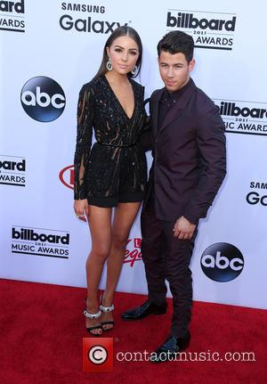 Olivia Culpo and Nick Jonas - A variety of stars from the music industry were snapped as they arrived to...