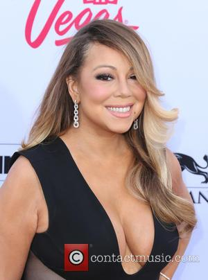 See Mariah Carey's Match.com Profile In The Vegas Set Video For 'Infinity'