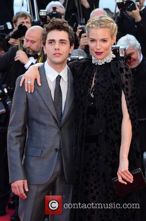 Sienna Miller and Xavier Dolan - A variety of celebrities were photographed as they took to the red carpet at...