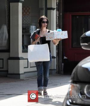 Rachel Bilson - Actress Rachel Bilson picking up a present at Juvenile Shop before buying baby bedrail for her new...