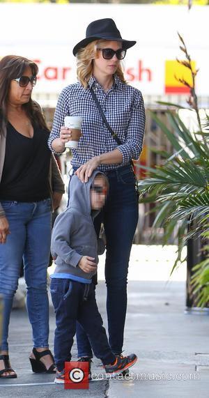January Jones and Xander Jones - January Jones grabs coffee from Starbucks with her son Xander in Los Angeles -...