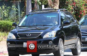 Calista Flockhart and Liam Flockhart - Calista Flockhart and her son driving about in Brentwood as Harrison Ford stays home...