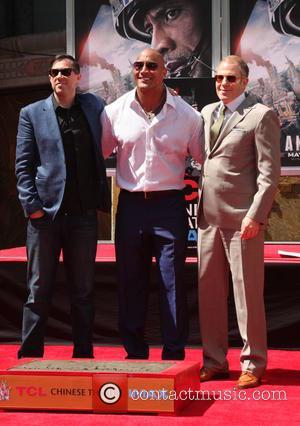 Brad Peyton, Dwayne Johnson and Toby Emmerich