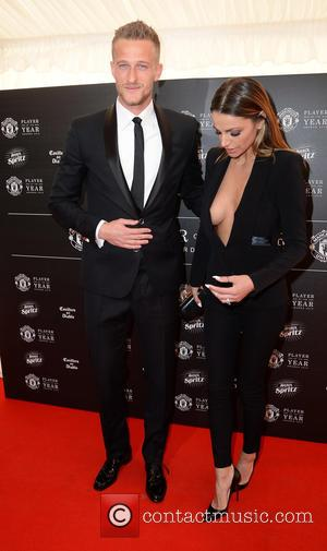 Anders Lindegaard and Misse Beqiri - Manchester United Player of the Year Awards 2015 - Arrivals - Manchester, United Kingdom...