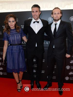 Robin Van Persie, Bouchra Van Persie and Daley Blind - Celebrities arrive at Manchester United Football Club, Old Trafford, Manchester...