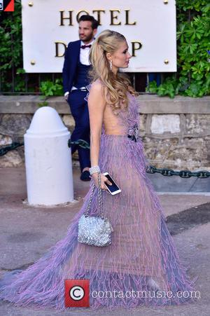Paris Hilton - 68th Cannes Film Festival - A variety of celebrities were photographed as they arrived to amfAR's Cinema...