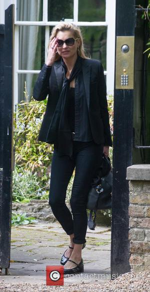 Kate Moss Escorted Off Plane - Report