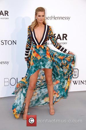 Toni Garrn - 68th Cannes Film Festival - A variety of celebrities were photographed as they arrived to amfAR's Cinema...