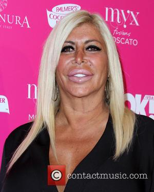 Family And Friends Gather At Big Ang Memorial