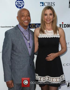 Russell Simmons and Mira Sorvino - 17th Annual CAST From Slavery To Freedom Gala at Skirball Cultural Center - Los...