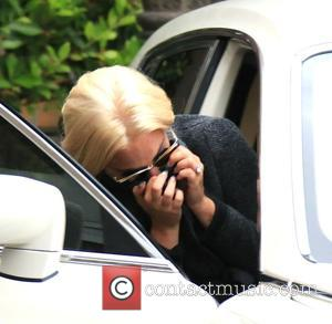Lady Gaga - Lady Gaga hides her face as she leaves Epione Cosmetic Laser Center - Beverly Hills, California, United...
