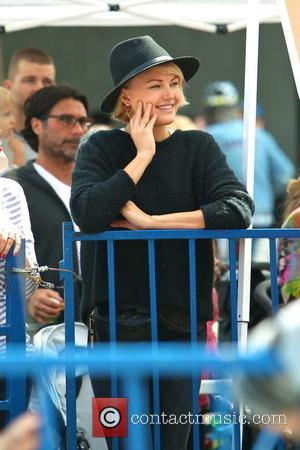 Malin Akerman - Malin Akerman takes her son to the Studio City Farmers Market during Memorial Day Weekend. They rode...