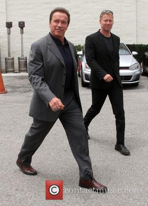 Arnold Schwarzenegger - Arnold Schwarzenegger carrying his Apple laptop, leaves a restaurant in Beverly Hills after lunching with friends -...
