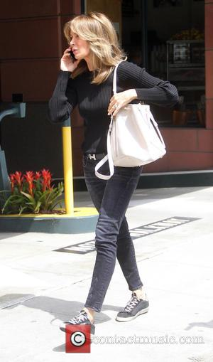 Jaclyn Smith - Charlie's Angel Jaclyn Smith busy talking on her cell phone as she goes shopping in Beverly Hills...