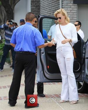 January Jones - Celebrities attend Joel Silver's Memorial Day Party at Malibu CA - Los Angeles, California, United States -...