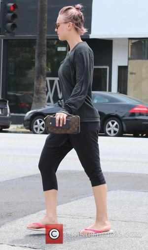 Kaley Cuoco - Kaley Cuoco with her dyed pink hair tied back into a bun, leaves her yoga class in...