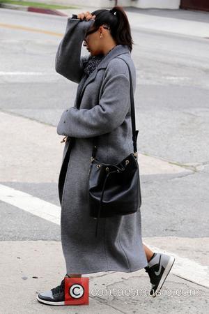 Naya Rivera - A very pregnant Naya Rivera shops at Bel Bambini wearing an over-sized grey coat at West Hollywood...