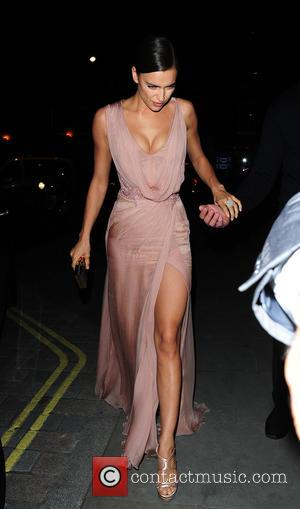 Irina Shayk - Irina Shayk arrives at her hotel in an evening gown after watching 'The Elephant Man' at Theatre...
