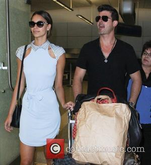 Robin Thicke and April Love Geary - Robin Thicke at Los Angeles International Airport (LAX) with his young girlfriend April...