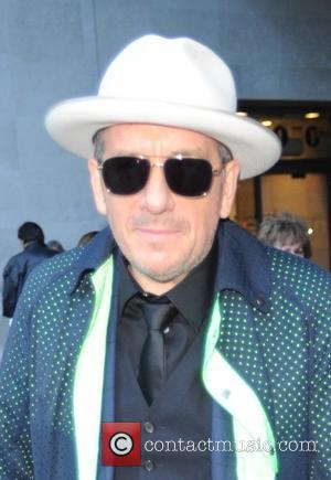 Elvis Costello - Elvis Costello leaves the BBC Radio 1 studios after a performance on 'The One Show' - London,...