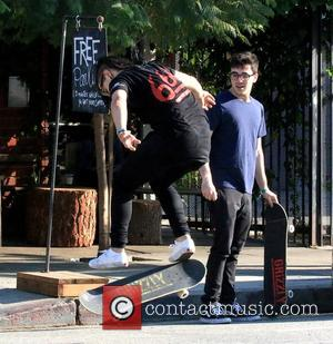 Dj Skrillex - Dj Skrillex sighted doing skateboarding tricks in Downtown Los Angeles - Los Angeles, California, United States -...