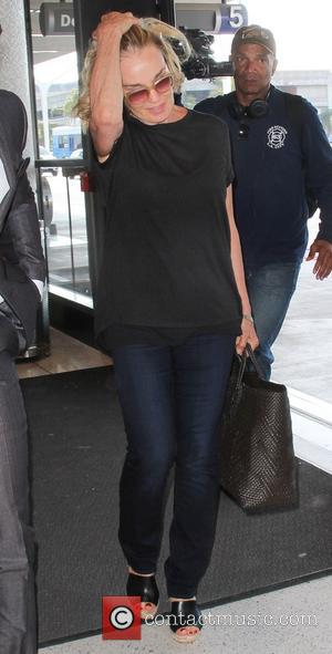 Jessica Lange - Jessica Lange dressed all in black arrives at Los Angeles International Airport (LAX) at LAX - Los...