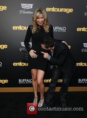 David Faustino and Lindsay Bronson - Warner Bros. Pictures' L.A. Premiere of 'Entourage' held at The Regency Village Theatre -...