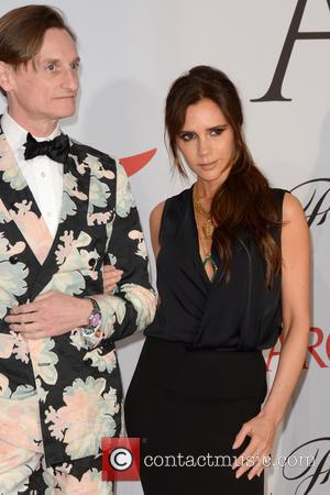 Hamish Bowles and Victoria Beckham