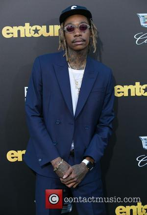 Wiz Khalifa Handcuffed At LAX After Refusing To Get Off His Hoverboard