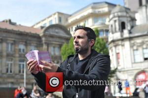 Dynamo - Magician Dynamo visits Birmingham and performs some magic tricks on the public at Victoria Square - Birmingham, United...