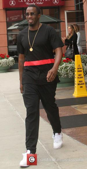 Sean Combs - Sean Combs is all smiles as he leaves an office in Beverly Hills wearing all black with...