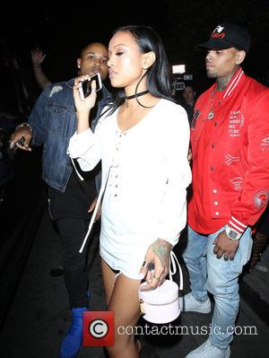 Karrueche Tran and Chris Brown - Karrueche Tran appears far from happy as she leaves Playhouse Nightclub in Hollywood with...
