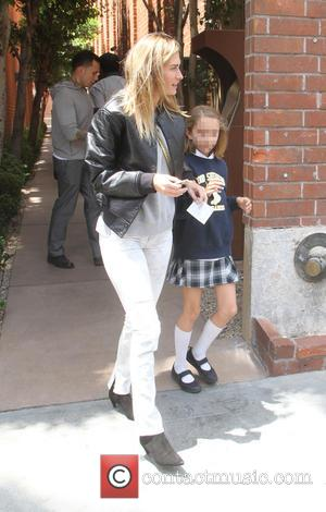 Rhea Durham and Ella Rae Wahlberg - Rhea Durham withdraws cash from an ATM with her daughter Ella Rae Wahlberg...