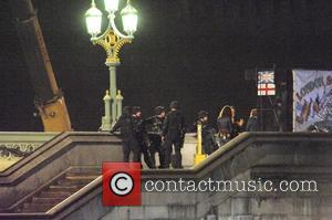 Police - Filming scenes for James Bond movie 'Spectre' taking place on location at Westminster Bridge over the River Thames....
